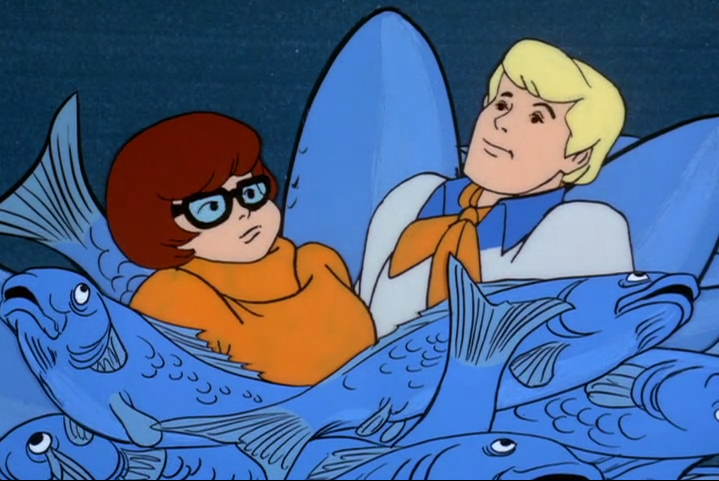 In the years that followed, Velma often thought back on the look of serenity that washed over Fred's face at that moment. Was it the fish? Was it her? Velma never did find out what was going through Fred's mind as their fingers met inside of a carp.