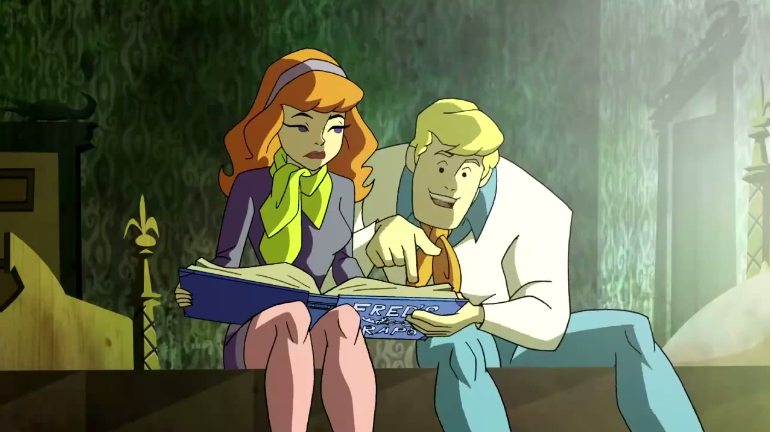 Fred lectures Daphne about the many entries in his Mansplaining Scrapbook.
