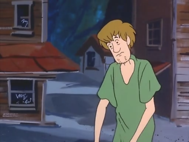 Shaggy reaches for his belt, ready to yank his handle and start his engine.