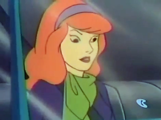 With the chorus of pizza toppings echoing throughout the van, Daphne fantasizes jerking the steering wheel from Shaggy's grasp.