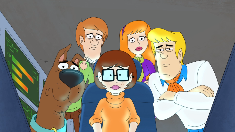 The gang watches with genuine concern as a deranged person on YouTube talks about how the best Mystery Machine is the red one from  13 Ghosts of Scooby-Doo .