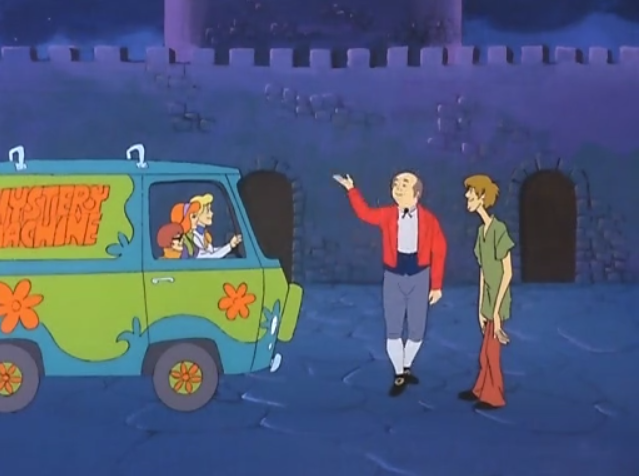 Jamie Craigmore greets the Mystery Machine in the traditional Scottish manner.