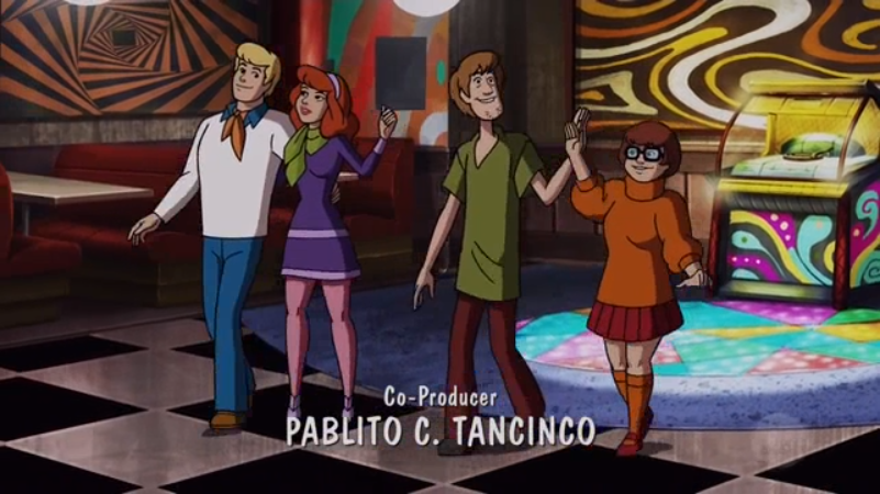 While Fred and Daphne walk off the dance floor with one arm around the other, Shaggy and Velma opt to wave at one another from less than two feet apart.
