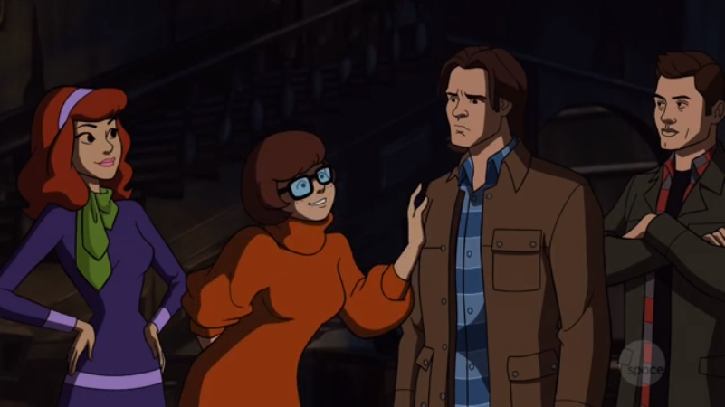 It's a little uncomfortable how Velma obsesses over Sam's broad, manly shoulders. Come on, Velma. Treat Sam like a real person and objectify his whole body: shoulders, pecs, glutes, quads, hammies, tris, abs, oblique abs, and all.