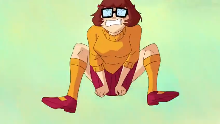 Velma regrets her choice of outfit for the Trickles Triquid X-Treme Hopscotch™ tournament.