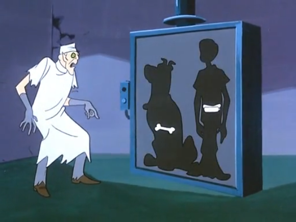 The Ghost of Dr. Coffin is appalled to see that Shaggy only has a single bone in his body.  Conversely, all Scooby's x-ray reveals is that he is, in fact, made up of (hot) dog.