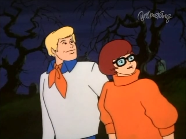 Fred and Velma raptly absorb the following screenshot and caption.