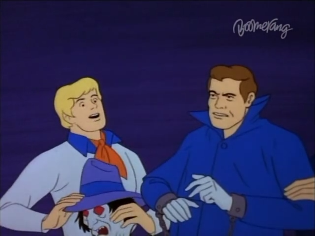 Fred couldn't believe it! The Phantom's face-skin sloughed right off! Even weirder, the skin underneath looked more normal than the old skin! Maybe the Phantom wasn't really a Phantom at all . . . maybe it was some kind of snake dude who shed his skin.