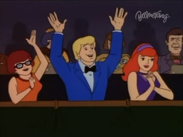Deciding that Fred was over-eager and Daphne far too restrained, Velma decided to moderate her excited arm motions.