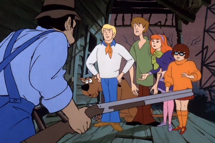 To take this picture at face value it's like Scooby is the one who knows what a gun is.