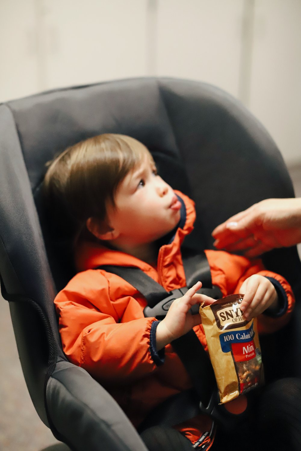 THE WRONG WAY: Do not wear puffy winter coats in a car seat.