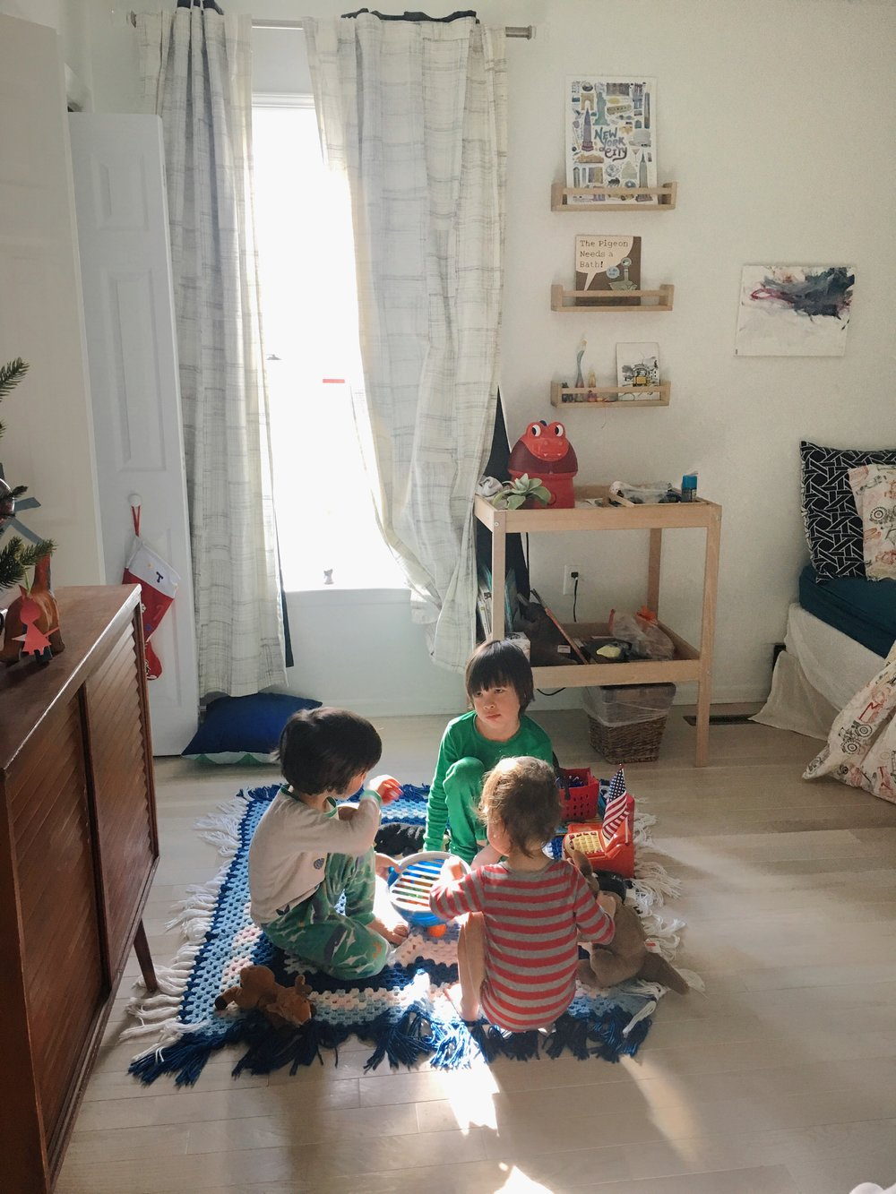 """10:36 a.m. - Kids are playing bank. Or is it bank robber? I don't know, there's something about lockdowns going on in there. I peek in quickly to make sure all is well, and I see Max has tagged up his little brothers with nametags that say """"I am Rowan I work at the bank"""". Atticus has an extra nametag that reads """"Best #1""""… I guess he's been made Employee of the Month?"""