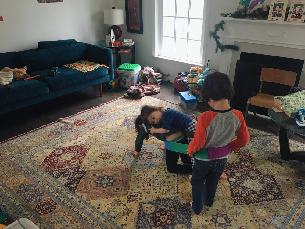 1:05 P.M. - While I clean up, the boys play for a few minutes before naptime. Max is giving free donkey rides (he's the donkey) to his brothers. I look over from the kitchen and I see Atticus draped on top of Max, who's crawling around on all fours lugging his baby brother like extra baggage. It's adorable but terrifying at the same time.