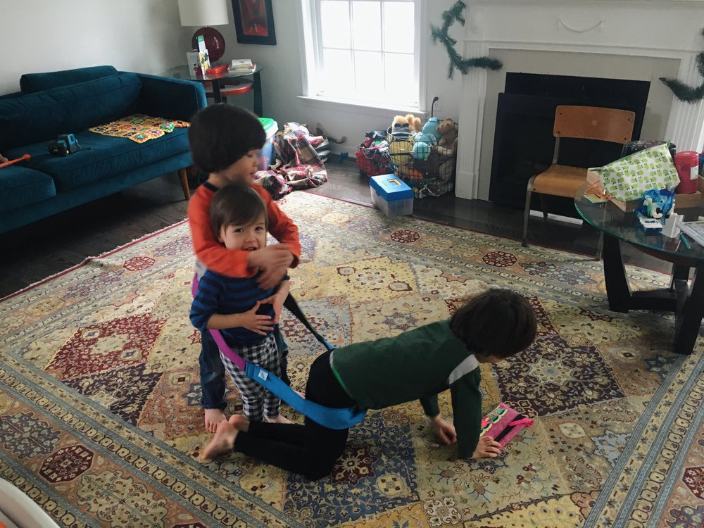 """5:45 P.M. - The glass is finally cleaned up and I make it downstairs to start cooking dinner. The boys are playing donkey rides again, mixed in with a little """"Let's do yoga!"""" (or their version of it anyway, which is them hanging upside down from our couch), and Kapla blocks."""
