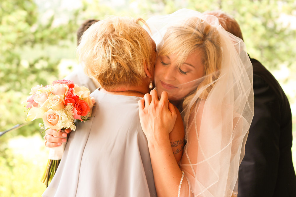 alexandra-rice-photography-estes-park-wedding-santa-cruz-bride-groom-ceremony-mother-hug.jpg