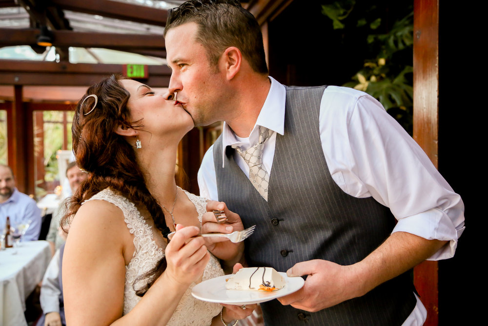 alexandra-rice-photography-shadowbrook-capitola-santa cruz-wedding-bride-groom-kiss-cake-cutting.jpg