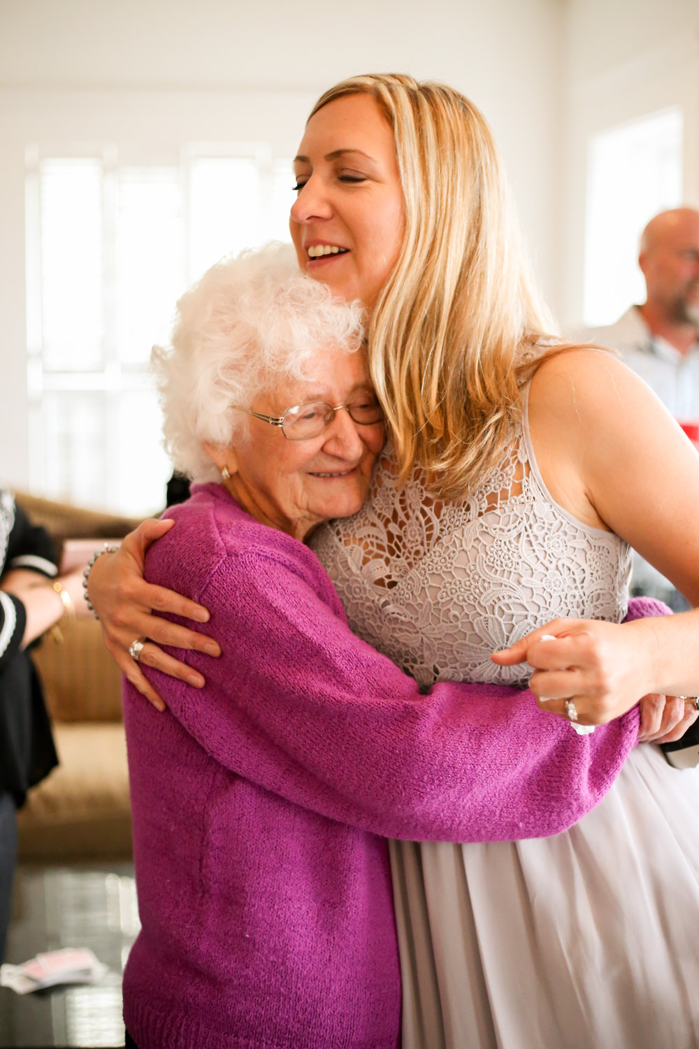 alexandra-rice-photography-pacific-grove-wedding-bride-grandma-hug.jpg