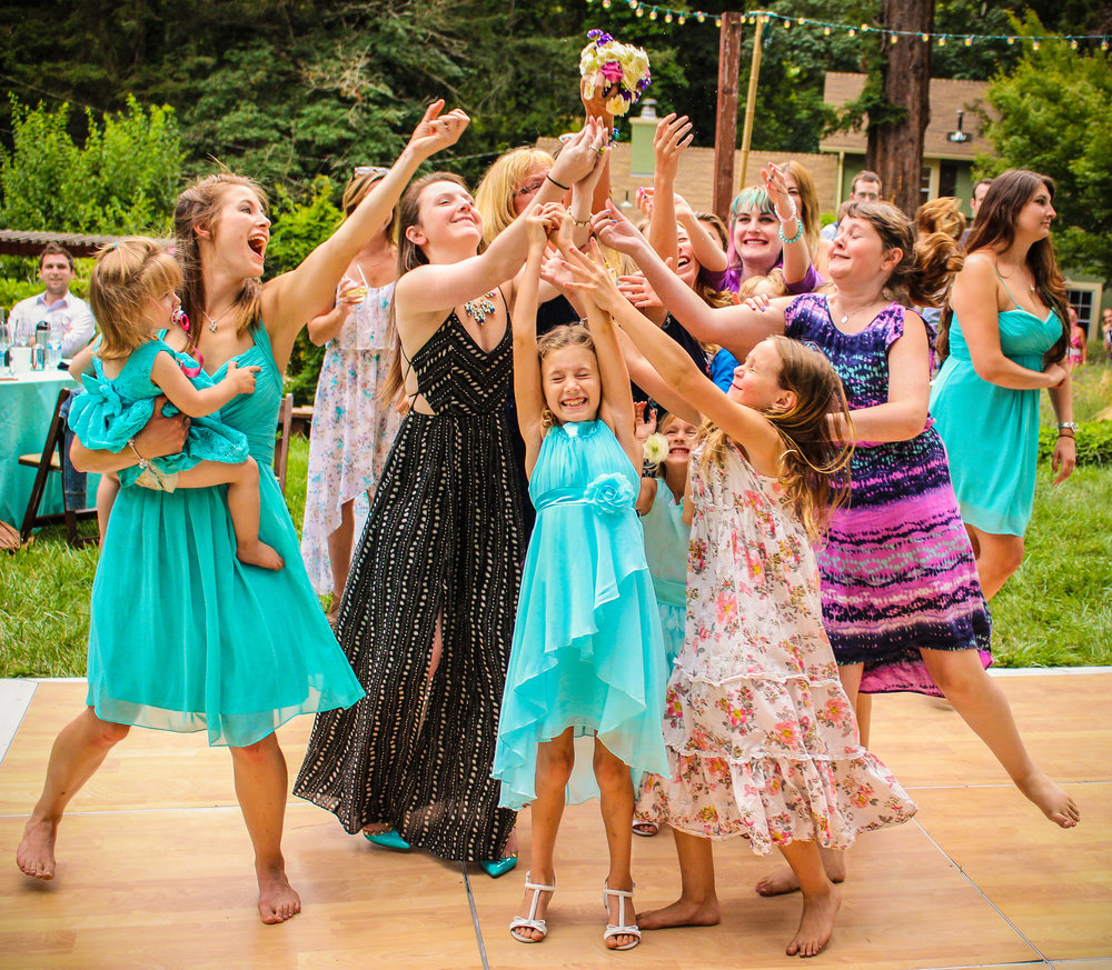 alexandra-rice-photography-santa-cruz-felton-wedding-boquet-toss.jpg