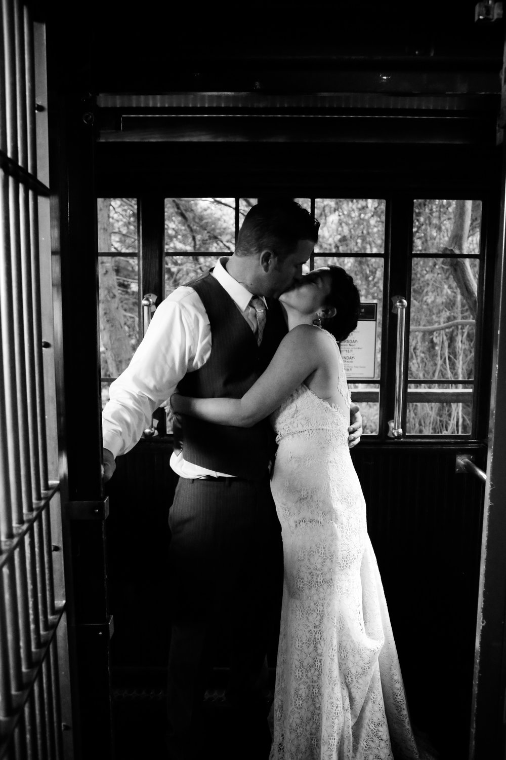 alexandra-rice-photography-shadowbrook-capitola-santa cruz-wedding-bride-groom-portrait-trolley-black-white-kiss.jpg