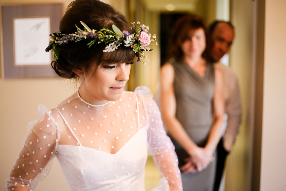 alexandra-rice-photography-monterey-wedding-bride-getting-ready-parents-watching.jpg