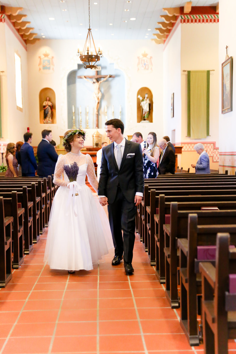 alexandra-rice-photography-monterey-wedding-bride-groom-just-married-walking-isle-san-carlos-cathedral.jpg