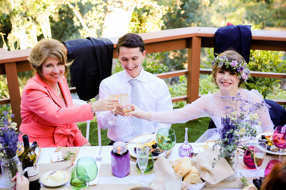 alexandra-rice-photography-monterey-wedding-bride-groom-mother-of-groom-reception-outdoors.jpg