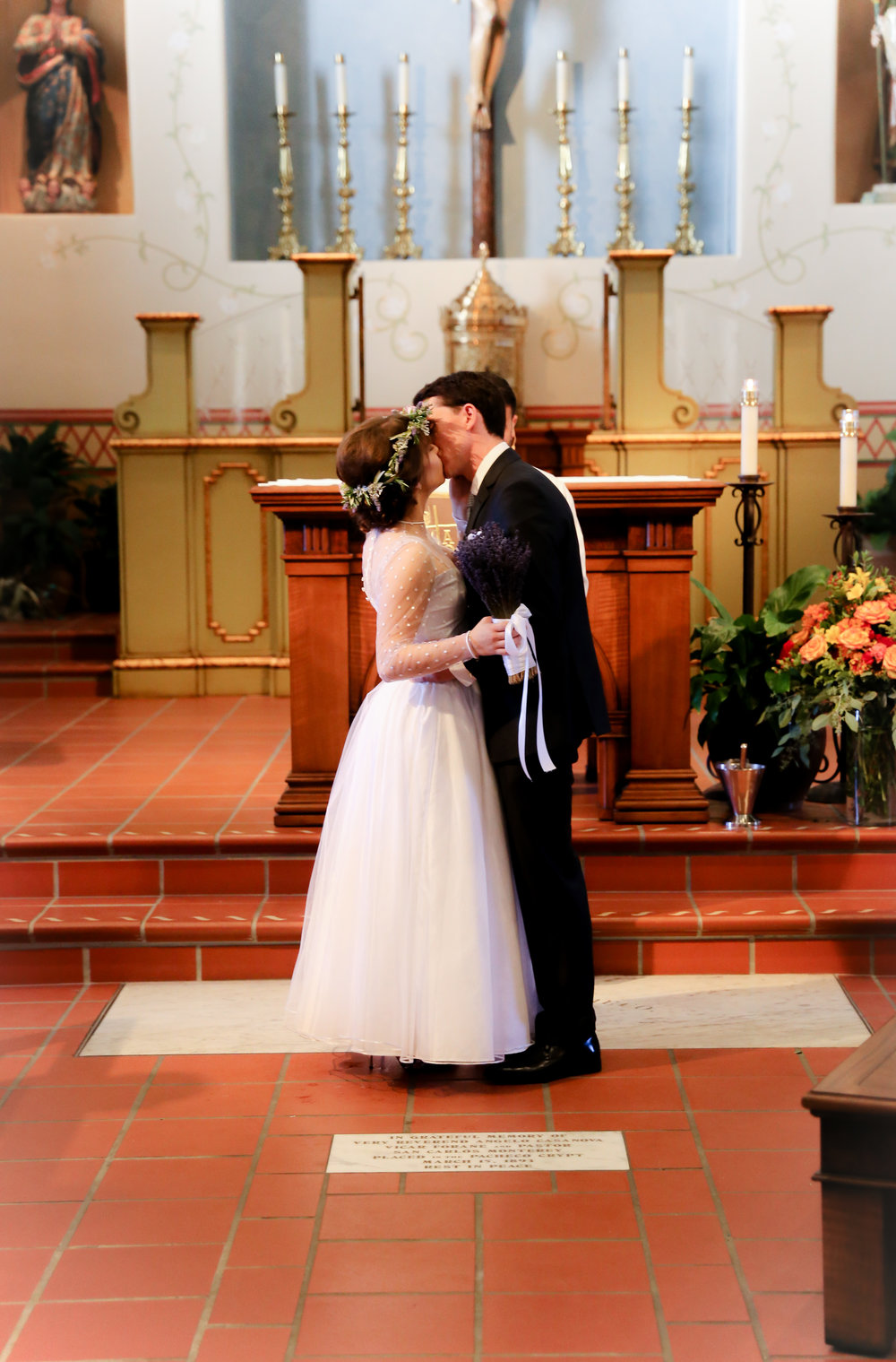 alexandra-rice-photography-monterey-wedding-bride-groom-kiss-san-carlos-cathedral.jpg