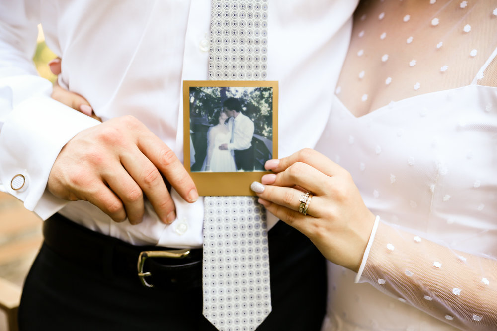 alexandra-rice-photography-monterey-wedding-bride-groom-polaroid-kissing.jpg