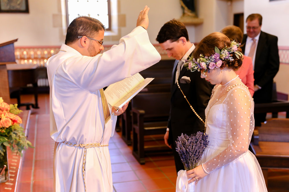 alexandra-rice-photography-monterey-wedding-bride-groom-vows-ceremony-priest-catholic-san-carlos-cathedral.jpg