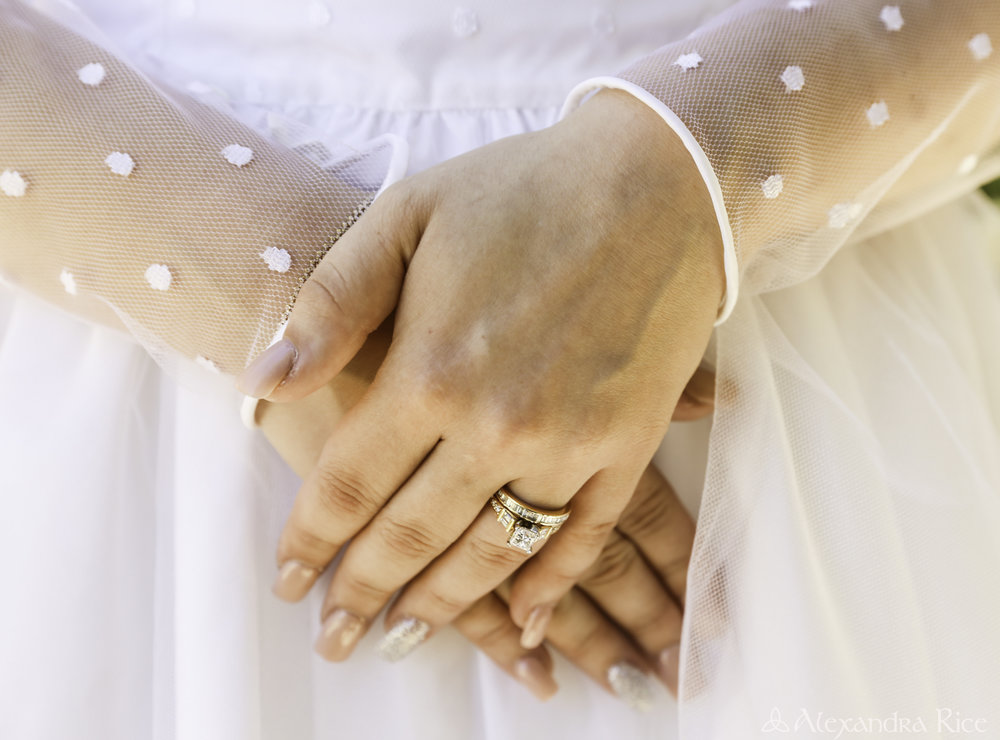 alexandra-rice-photography-monterey-wedding-bride-rings-san-carlos-cathedral.jpg