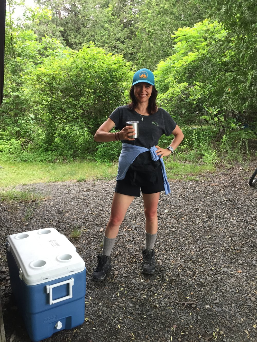 Pictured, top to bottom: Happy Camper hat, Happy Camper smile, Happy Camper cup, sunburnt thighs, wool socks (remembered!), hikers borrowed from a 10-year-old boy.