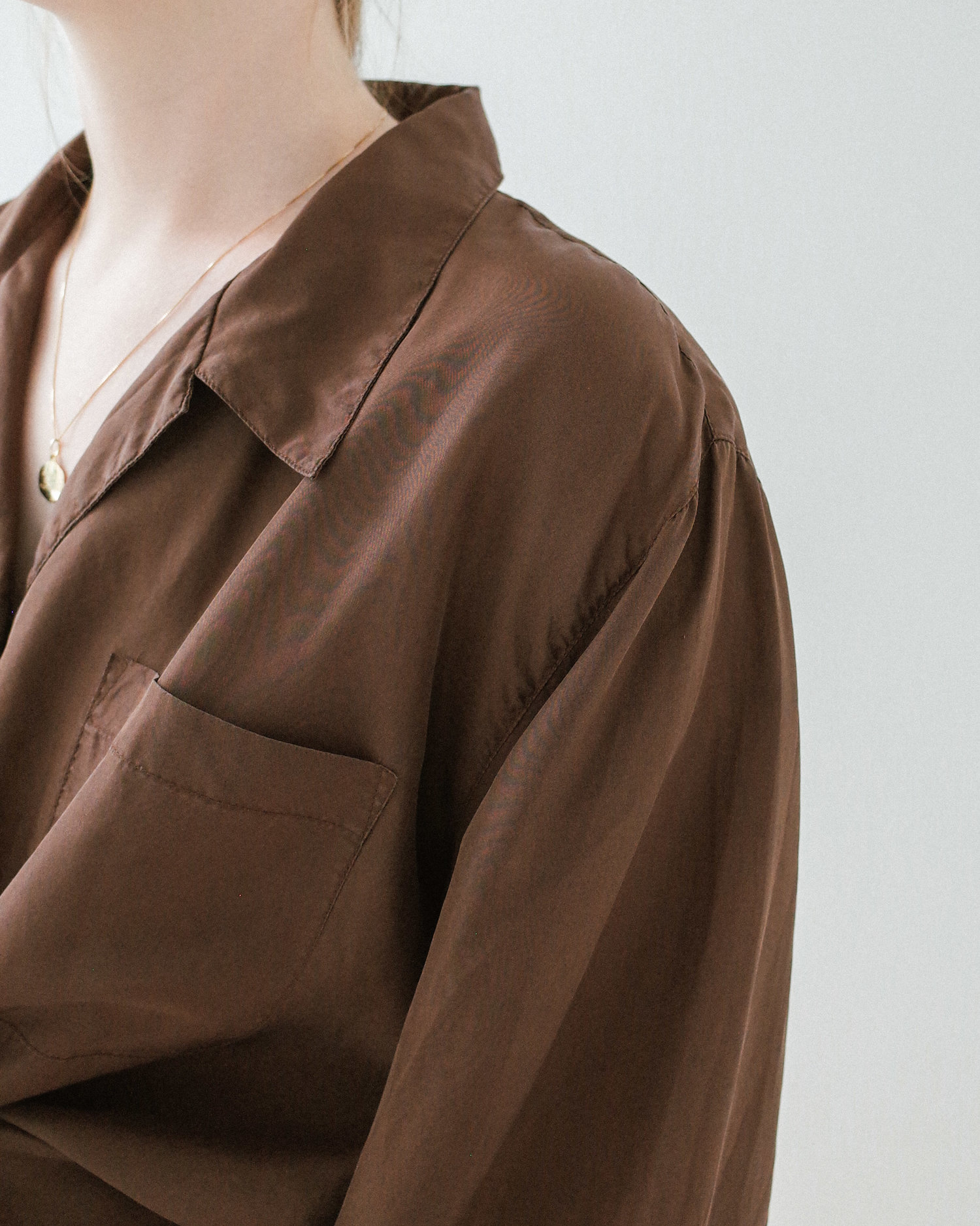 37edd621 brown silk button up blouse with capiz shell button