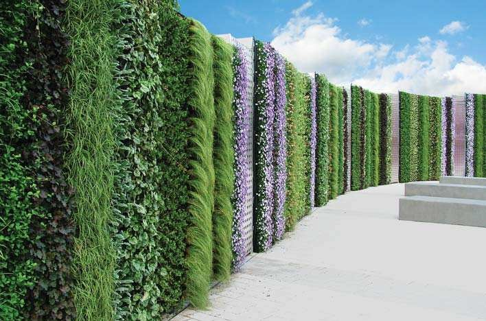 The NEC - Birmingham, United Kingdom - The Living Wall is purposed to provide a striped living wall as a sound barrier and beautiful visual addition to the site. ANS Global, Living Wall system founders, transform this event venue with the proven system.