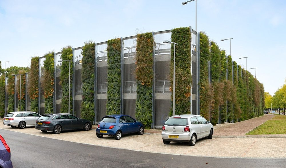 Granta Park Carpark - Cambridge, United Kingdom - This large business park near Cambridge includes a three storey car park with living walls, supplied by ANS Global (SMI Partner)on the external facade. The plants help disguise the building and make it blend in to the surroundings.