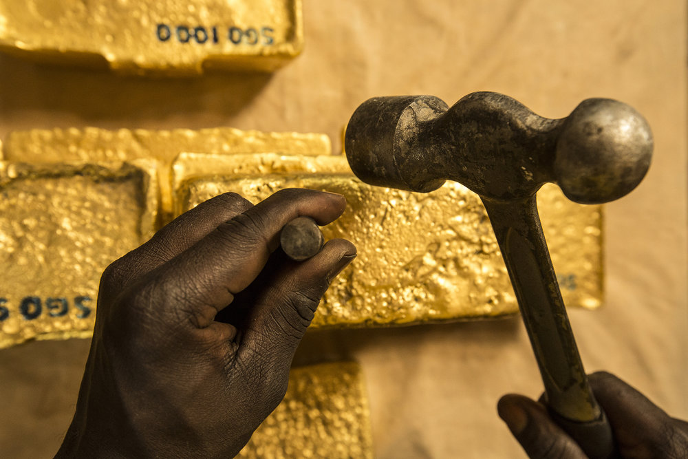 Stamping Newly Poured Gold Bars, Africa, 2012.  Edition of 3.