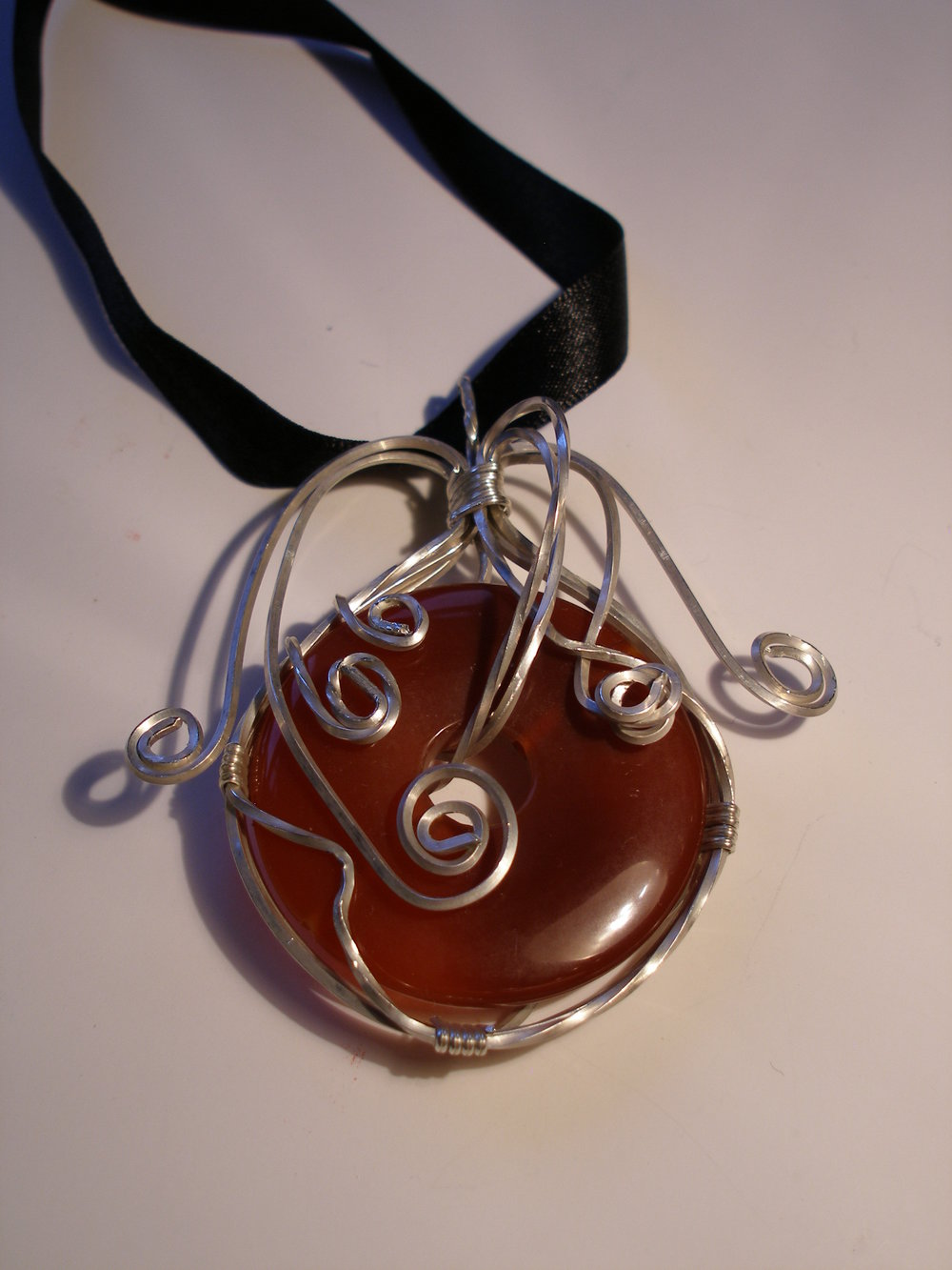tanis tempest-hay website - orange celtic pendant.jpg