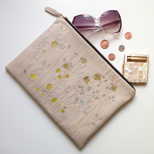 Embroidered metallic wildflower clutch bag by PaperCuttsDesigns