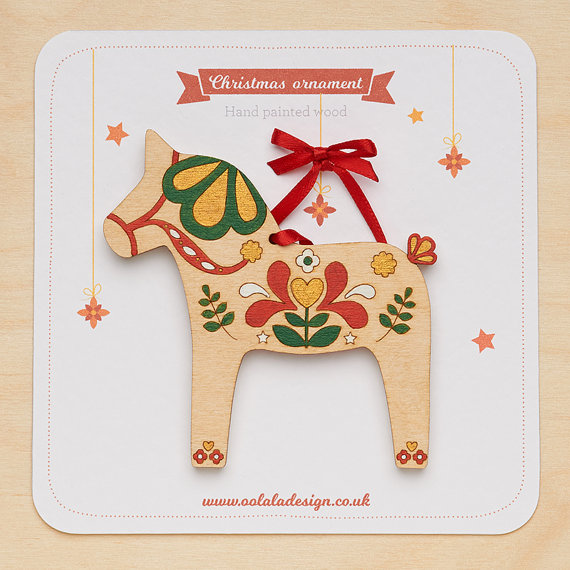 Handpainted Scandinavian inspired, these dala horse decorations are laser cut and based on original drawings by Oolala Design.