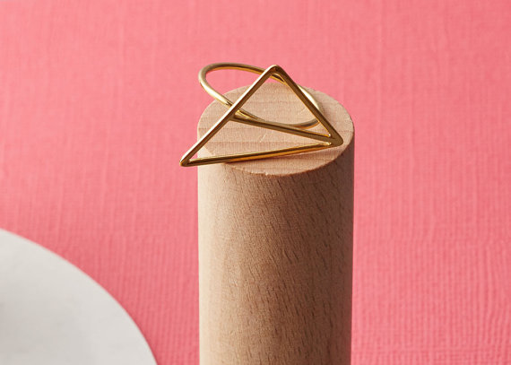 Ring by  Little Storm Designs . Founder and maker, Claire, has worked in an architecture office for many years, and is influenced by geometry and industrial materials that are found within architecture. She interweaves these influences with softer elements to create unique handmade jewellery.
