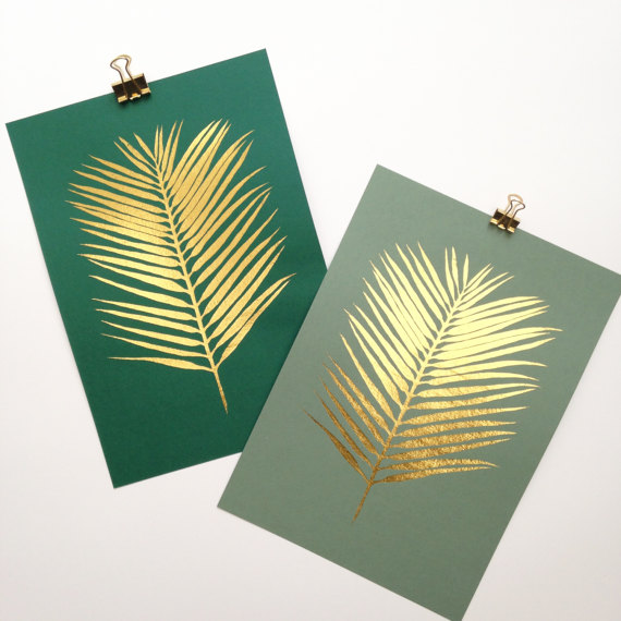 These gold foil palm leaf prints are by  Hello Marilu