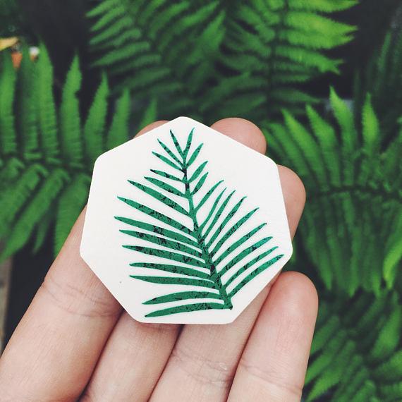 Palm leaf brooch by  Lucie Ellen .