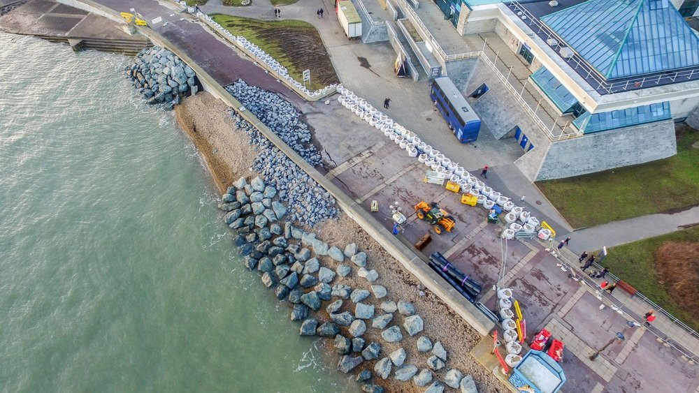 Above: rocks placed on the seafront beside The Pyramids Centre after sea defences crumbled in December 2015