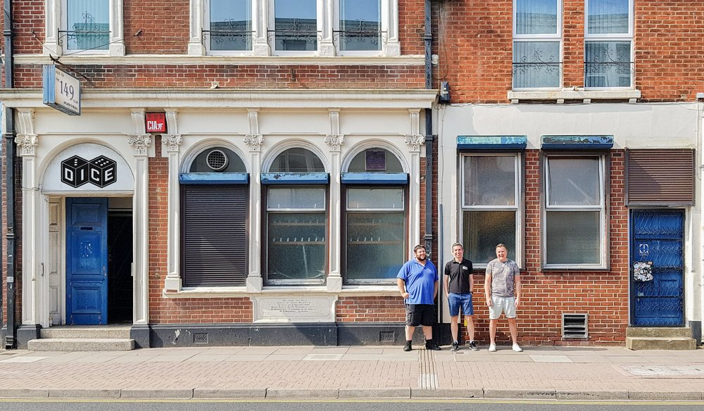 From left to right: Andy, Rikki, and Lee — and a mockup of what the Dice logo could look like over the Conservative Club entrance!