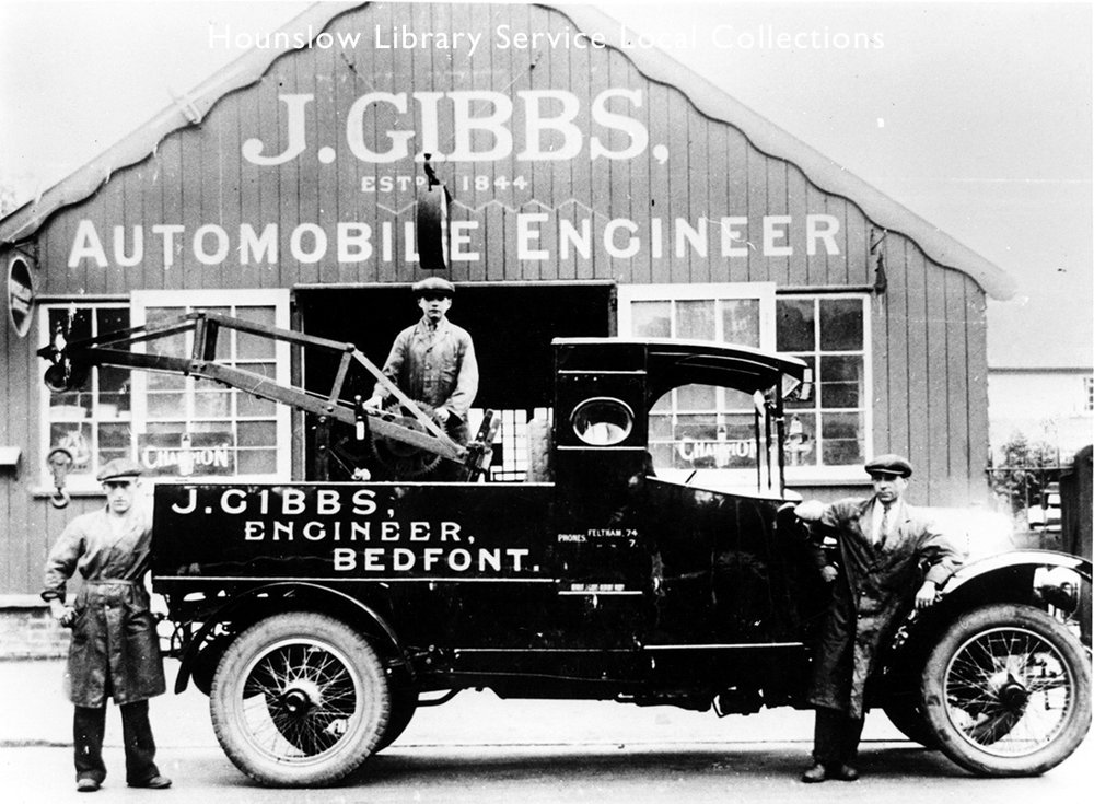 Gibbs workshops with road water pump, wheelbarrows and ploughs outside  Hounslow Library Service, Local Collections