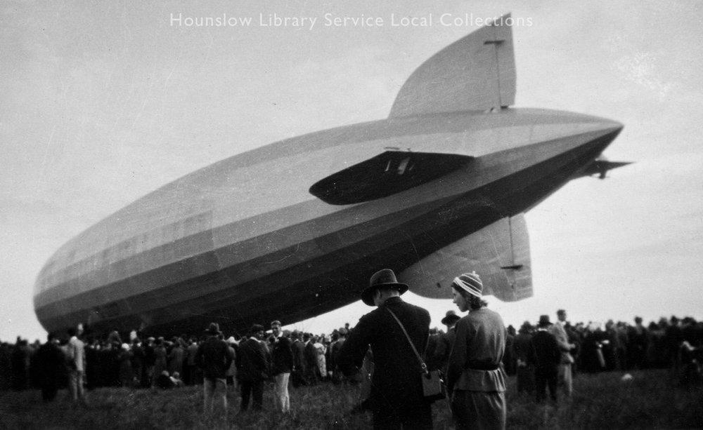 Graf-Zeppelin-at-Hanworth,-crowd-around-tail-of-(old--postcard).jpg