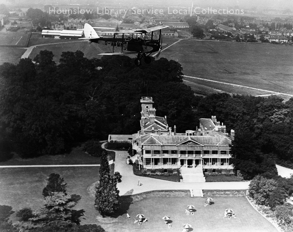 Hanworth-Air-Park,-the-clubhouse-from-the-air-with-bi-plane-(LS990)--1930's.jpg