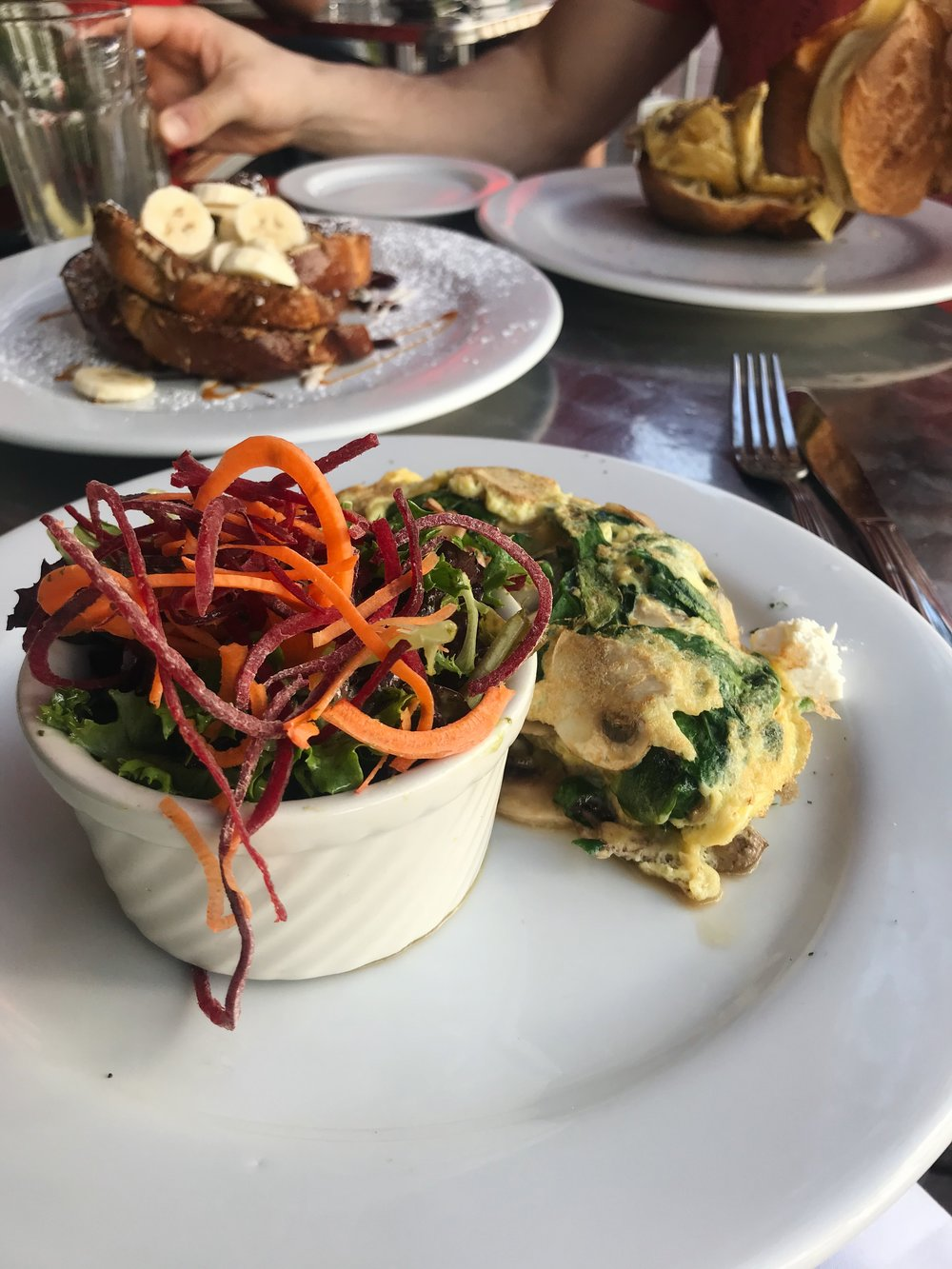 the three egg omelette, salad and thick French toast and Oliver's popovers in the background.