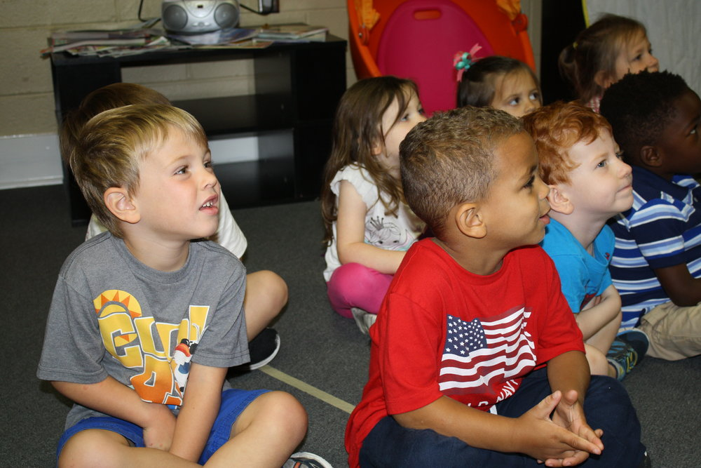 These K4 children are listening intently to a story!