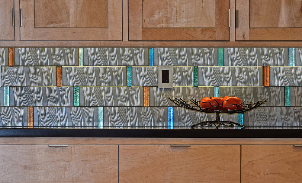 Tile Art - Change a kitchen or bar backsplash from ordinary, to remarkable, with an expression that complements the room and the space.