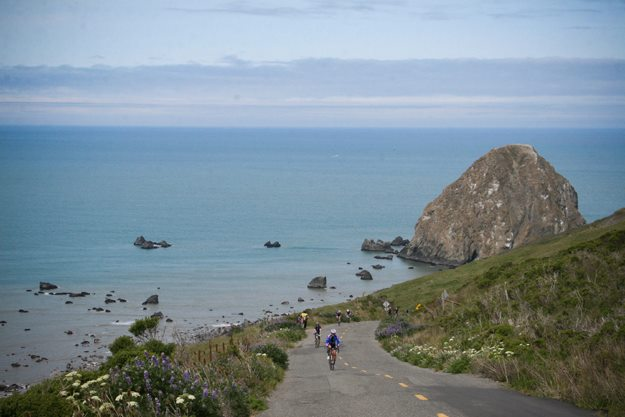 "Cyclists begin ascent of ""The Wall"" above Cape Mendocino. Photo courtesy of Tour of the Unknown Coast."
